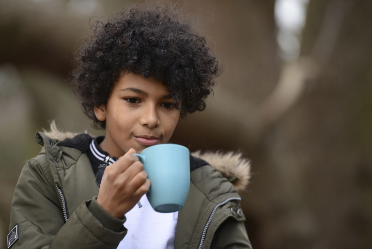 Boy drinking from a mug